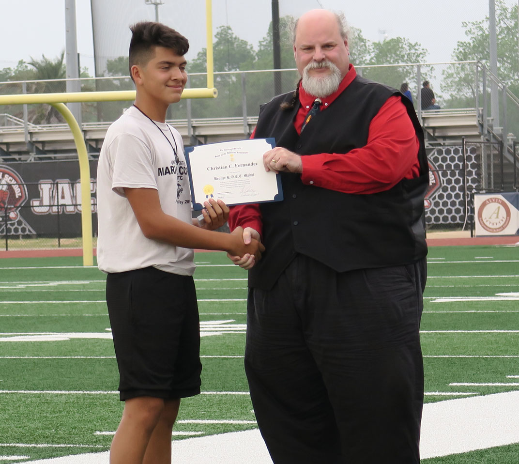 Cradle of Texas Chapter 33 SAR's Michael Bailey  presents the JROTC Bronze Medal To Alvin High School Recipient Marine Corps Cadet  Christian C. Fernandez.